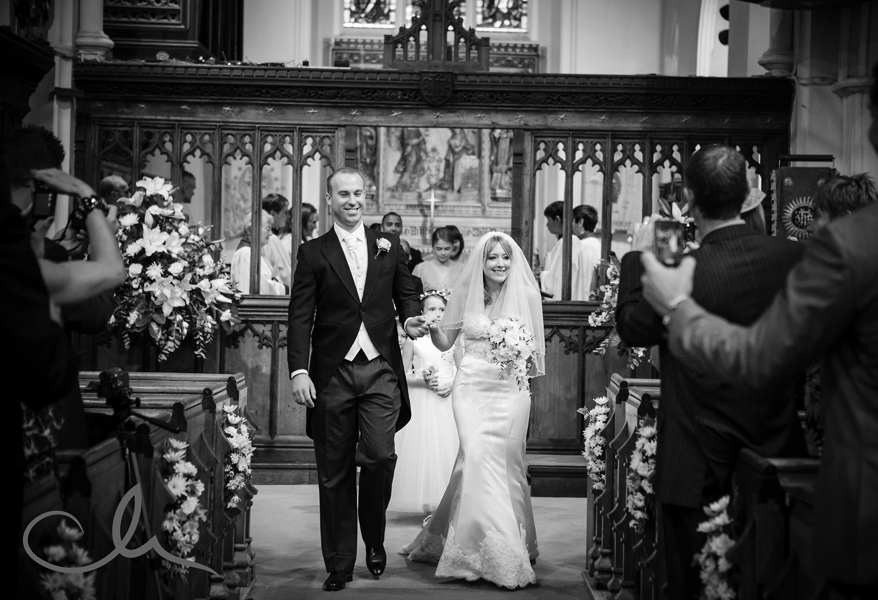 Bride and Groom walking down the Isle after ceremony at Chislehurst Church Kent