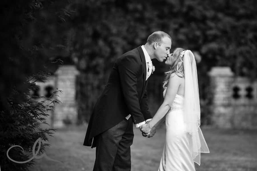 newly weds share a kiss at Sundridge Manor Hotel in Bromley Kent