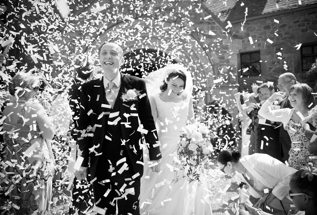 confetti and bride and groom at St Ouens Manor Jersey