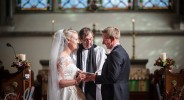 couple taking their wedding vows at St Mary's Church Chartham