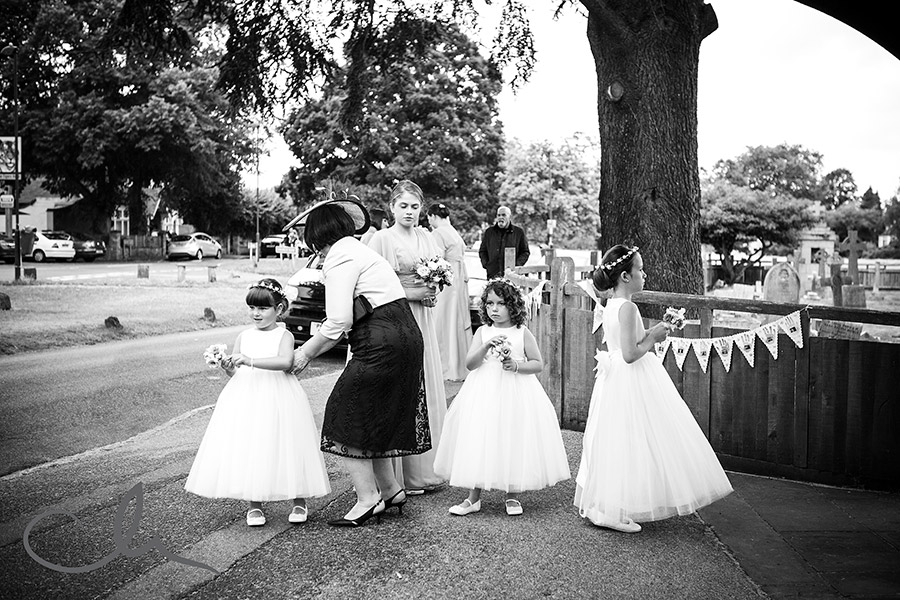 bridesmaids wait for brides arrival at St Nicholas Church Chislehurst Kent