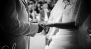 bride and groom exchanging rings at The Old Kent Barn wedding ceremony