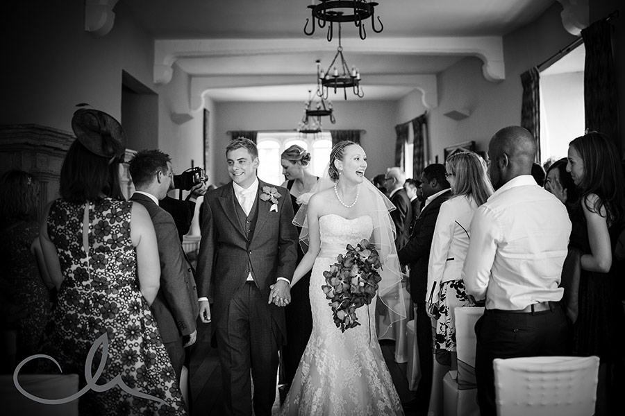 couple exit aisle at Leeds Castle Wedding