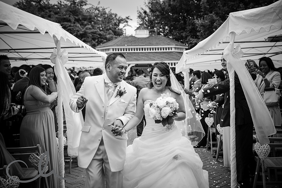 bride and groom dance down the isle at The Old Kent Barn
