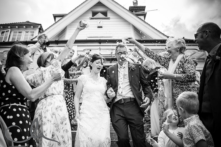 newlyweds at The Beacon House Whitstable and wedding confetti