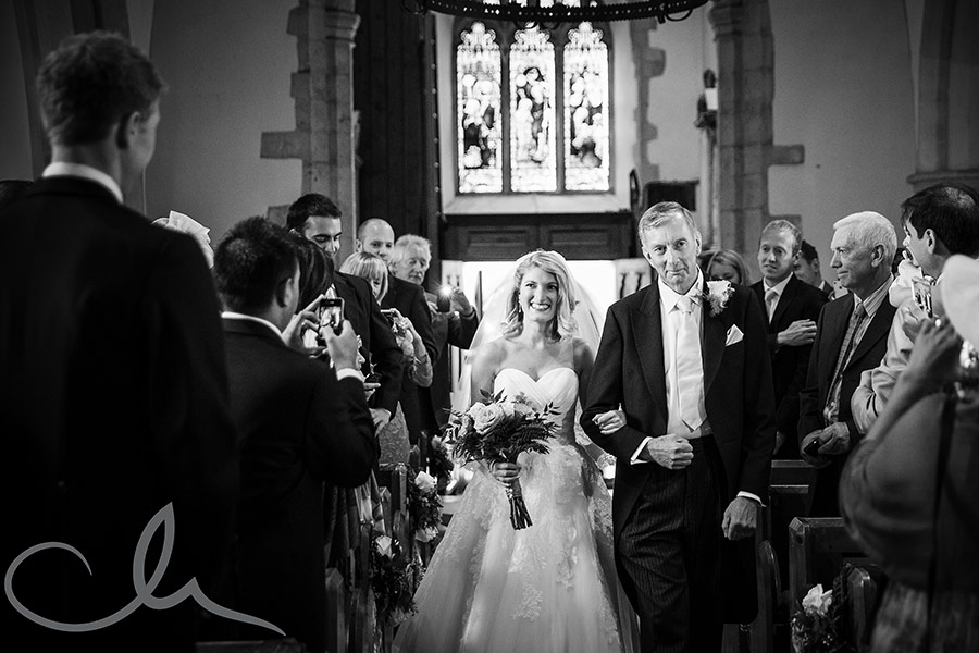 bride arrives with Father at St Peter and St Paul Church Boughton-Under-Blean
