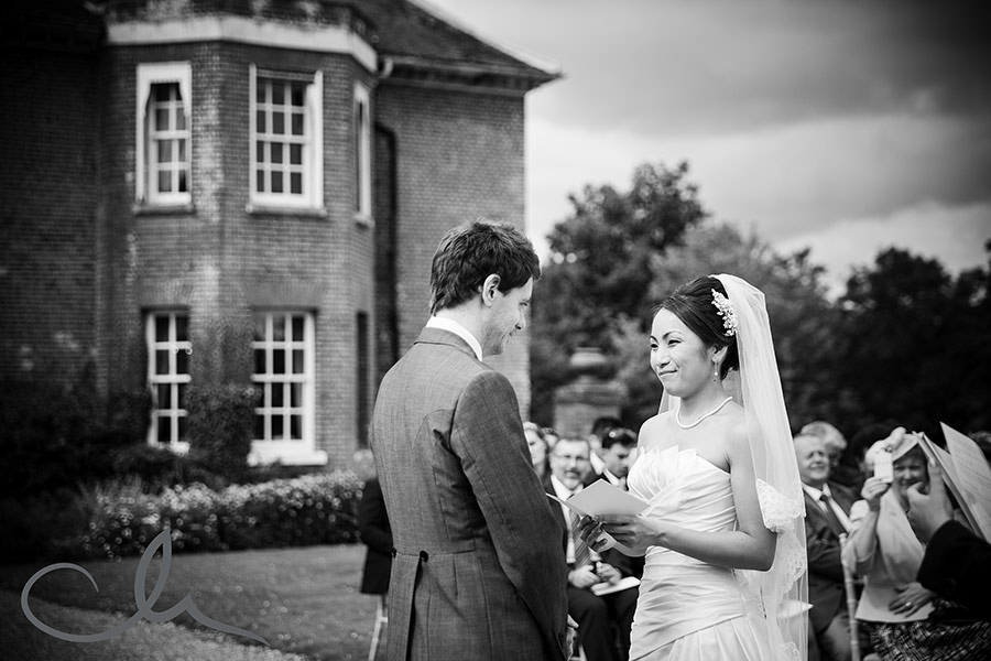 chilston park wedding photography - couple take their wedding vows