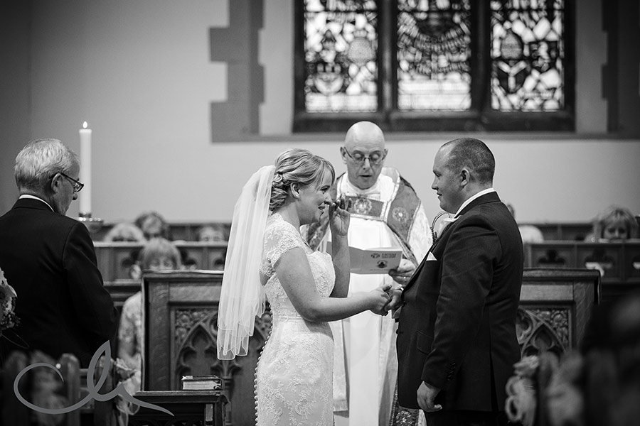 bride and groom take their vows at Holy Cross Church Bearsted Wedding