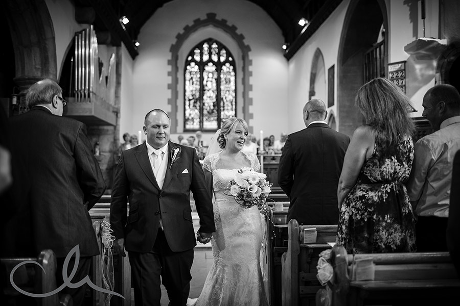 Newly weds exit the isle at Holy Cross Church Bearsted Wedding