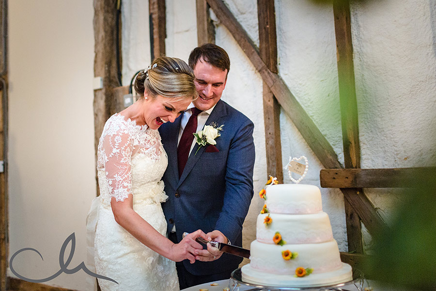 winters barns wedding photography - newly weds cut their wedding cake