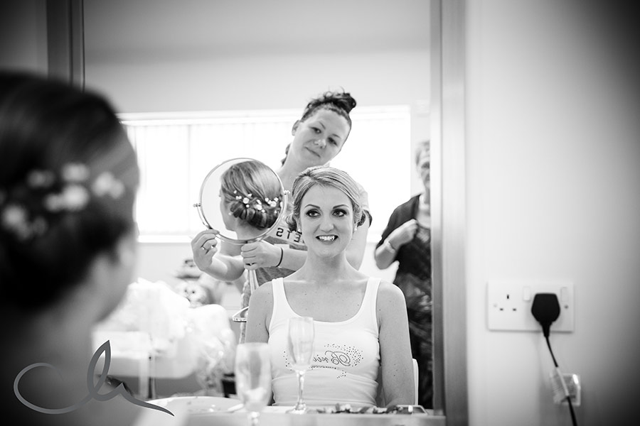 Bride has hair styled for her wedding at Winters Barns