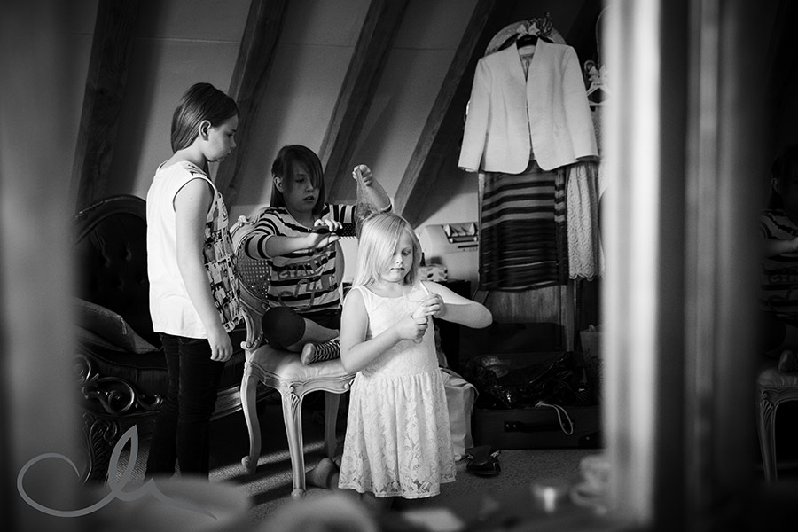 bridesmaids get ready for a wedding at The Old Kent Barn