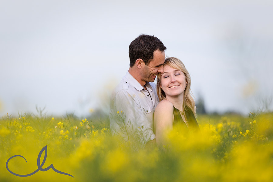 Kelli & Mark in a vivid yellow field - a good back drop for their engagement photos
