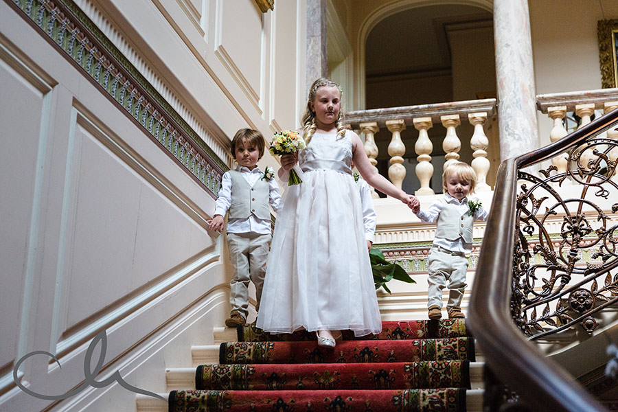 page boys and flower girl make their way down the stairs at Mount-Ephraim-Wedding