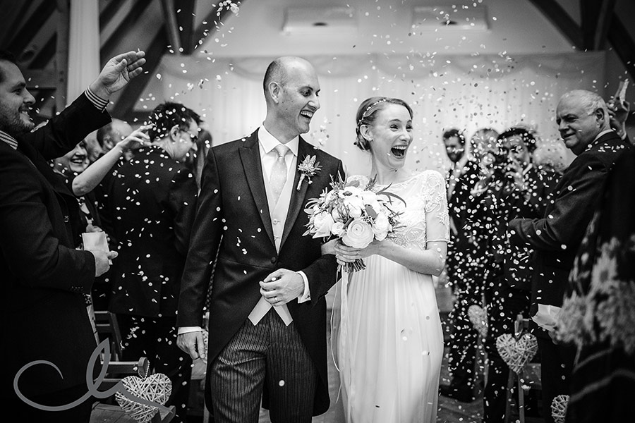 newlyweds are showered with confetti at their Old Kent Barn Wedding