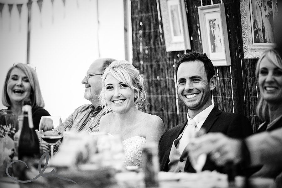 beautiful bride reacts to best man's speech at Great-Higham-Barn-Kent-Wedding-