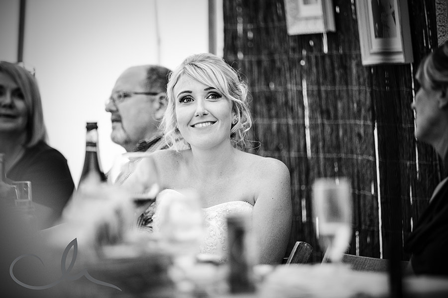 bride reacts to husbands speec at their Great Higham Barn Wedding