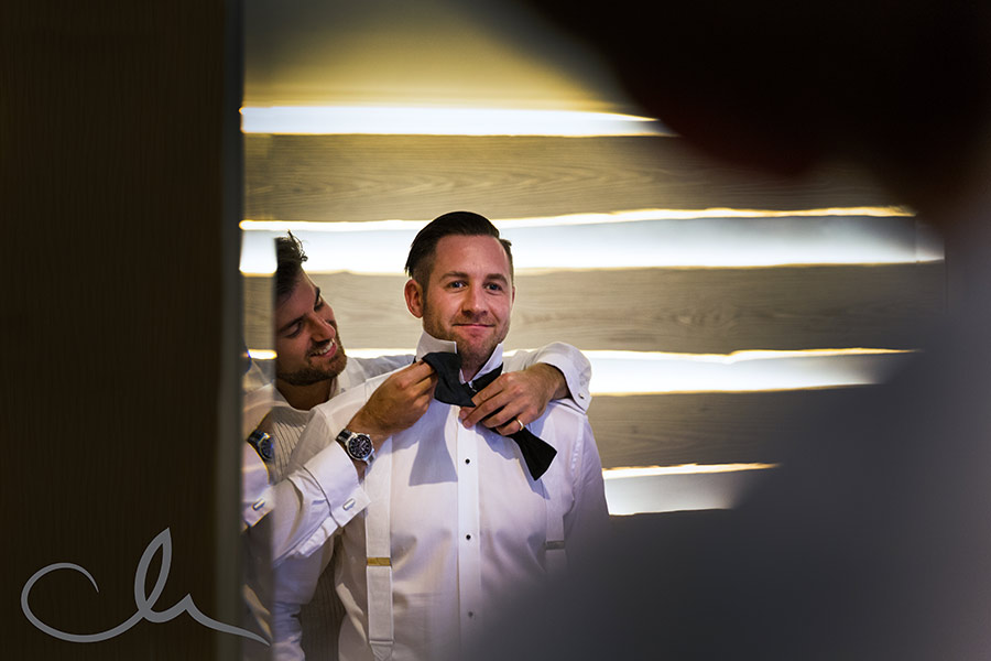 best man helps groom to get ready for his wedding at The Royal Yacht Jersey