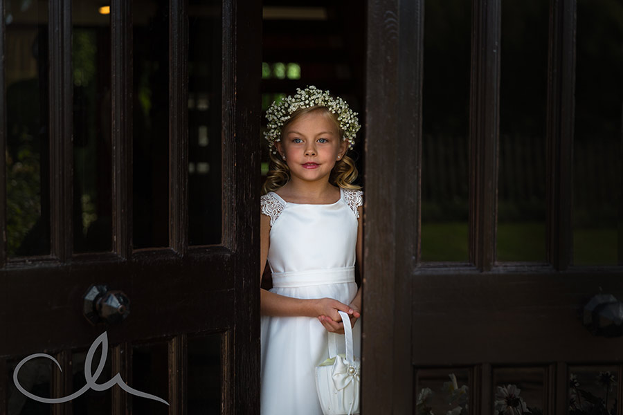 Flower girl waits for the Bride to arrive at The Old Kent Barn