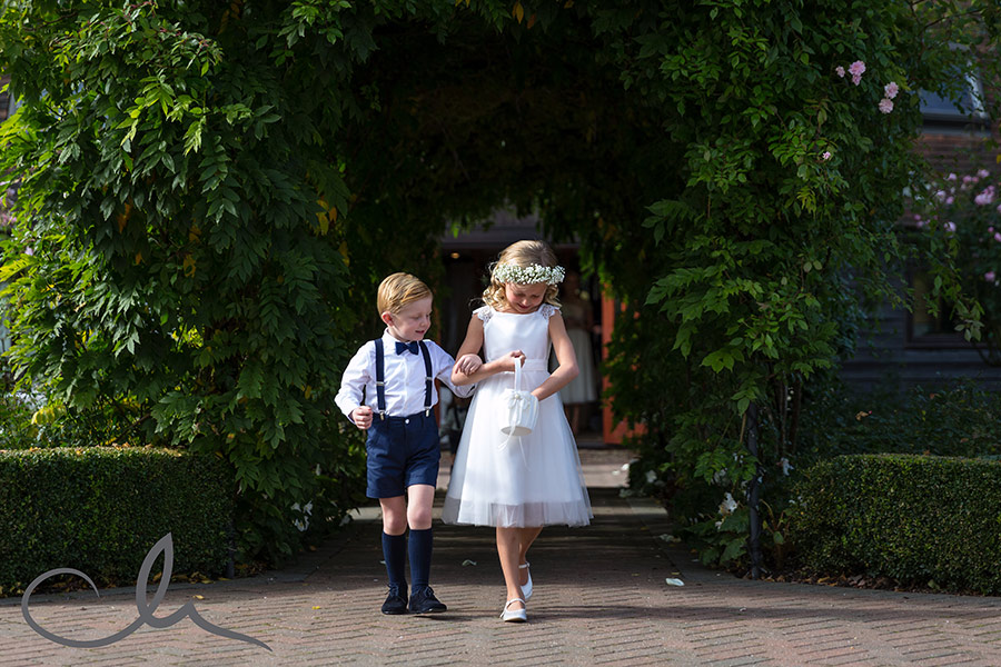 page boy and flower girl shower petals at Tom & Anastasia's Old Kent Barn Wedding
