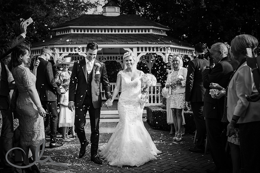 Tom and Anastasia's Old Kent Barn Wedding Photography - throwing the confetti!