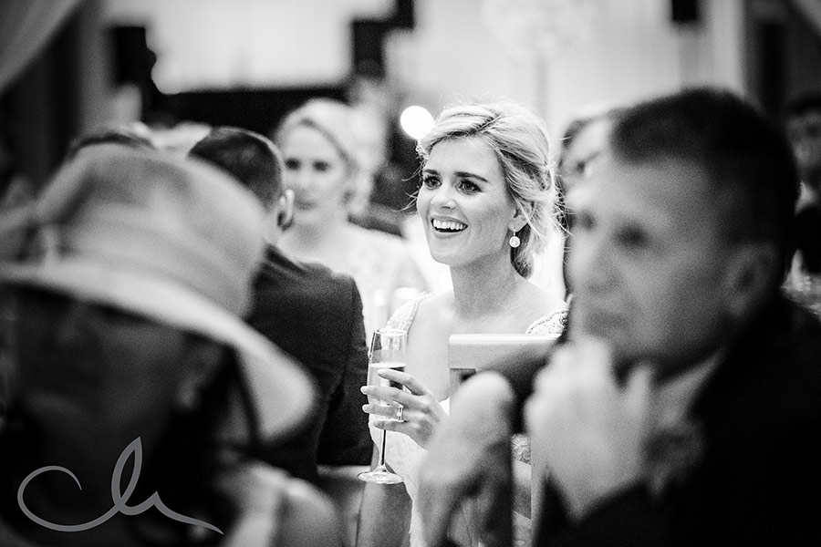 Bride reacts to speeches at their The-Old-Kent-Barn-Wedding