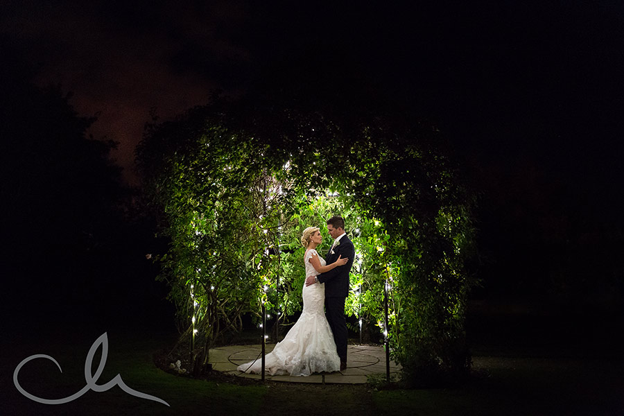 newlywed couple have twinkly light portrait shoot at The Old Kent Barn