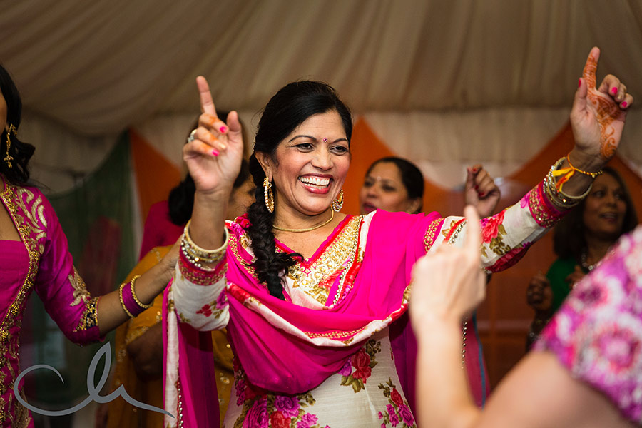 energetic music and dancing at the Mehndi Celebration