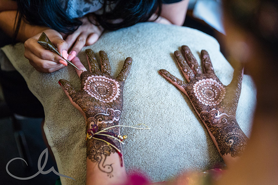 Rukmanie-and-David's-Mehndi-Celebration - henna being drawn on the bride's hands