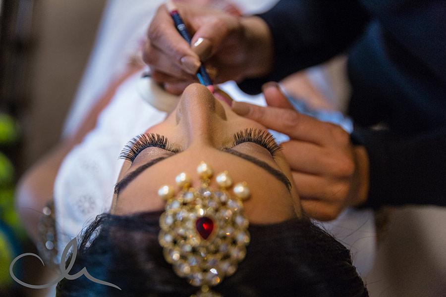 beautiful bride has her make up applied for her Sikh Wedding in Kent