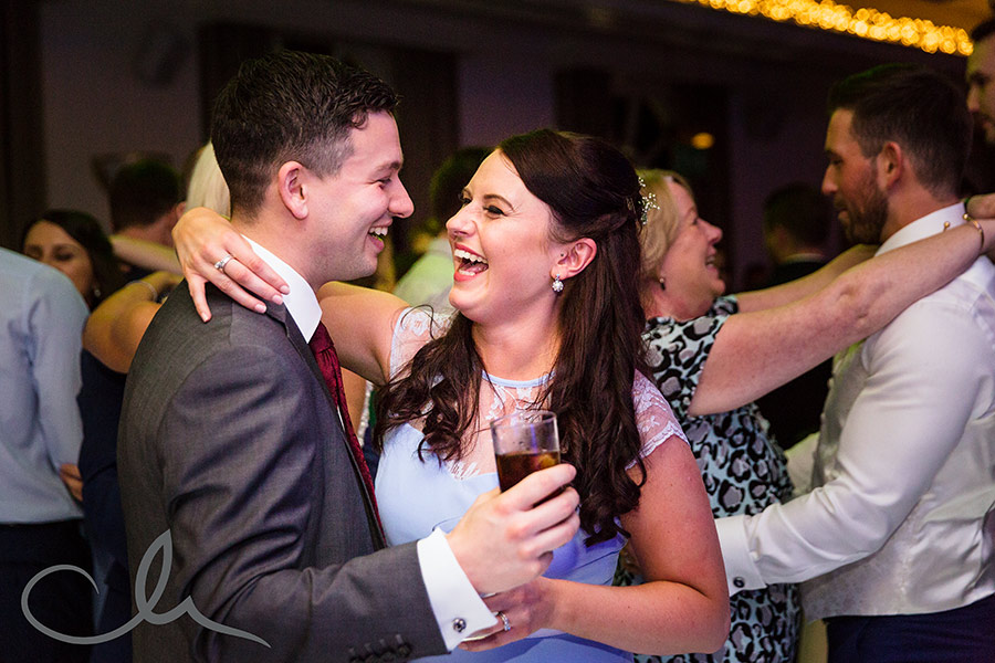 couple have fun on the dance floor at Orangery Maidstone wedding