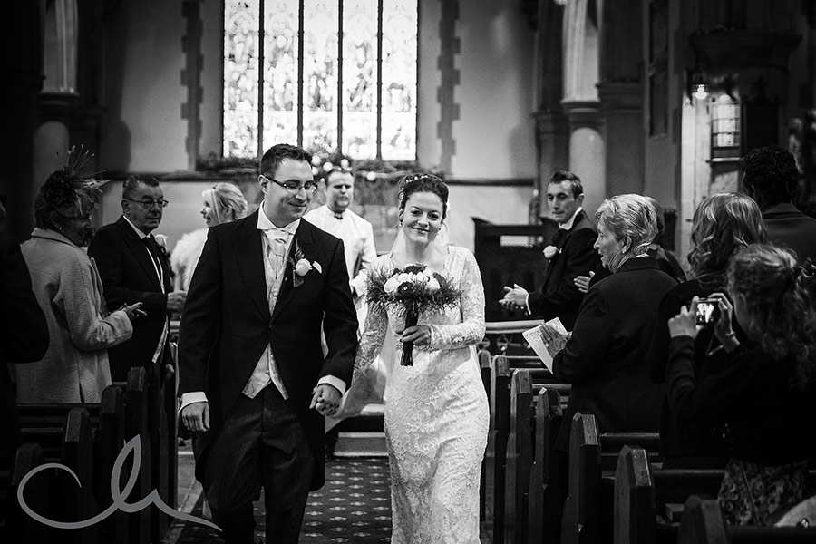 Sarah-&-Dan's-Chilham-Church-Wedding-photos-newlywed-couple-exit-the-church