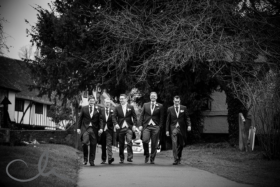 Dan and his groomsmen make their way to his Chilham Church Wedding