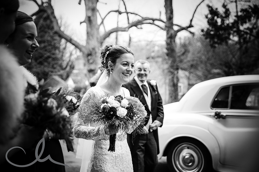 Sarah-&-Dan's-Chilham-Church-Wedding-photos-bride-arrives-at-the-church