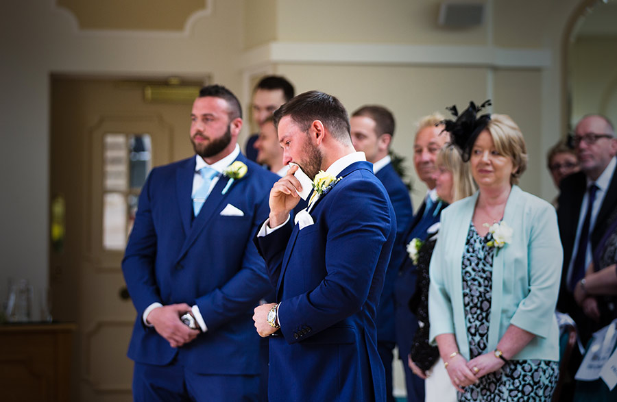 groom gets emotional as his bride arrives at The Orangery Maidstone wedding venue
