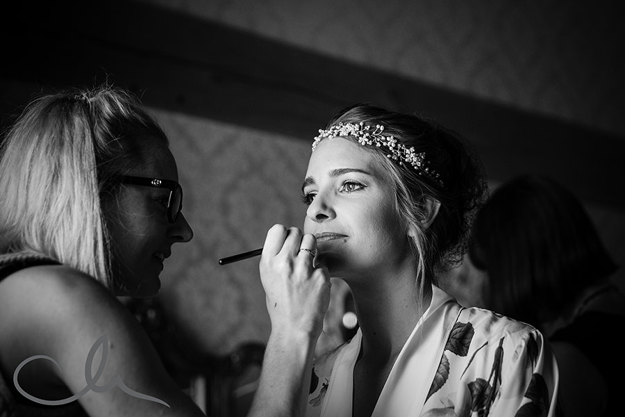 bride has her make up applied at The Old Kent Barn by Lucy Jane