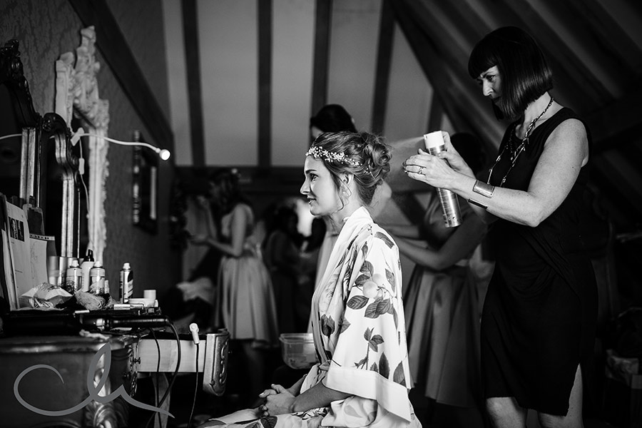 bride has her hair styled at The Old Kent Barn by Vicki Lord