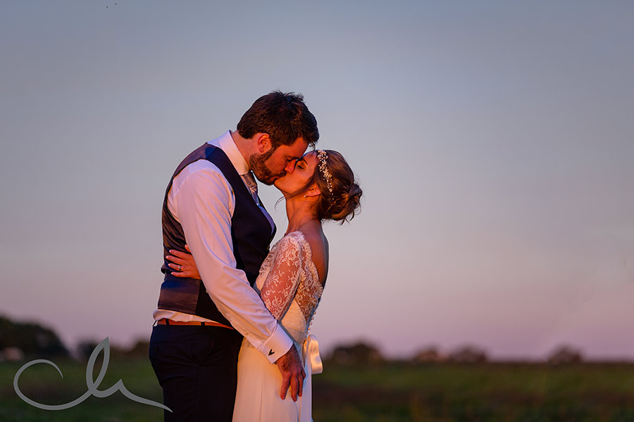 Claire & Tom's Old Kent Barn Wedding Photography - the couple have their sunset portrait shoot