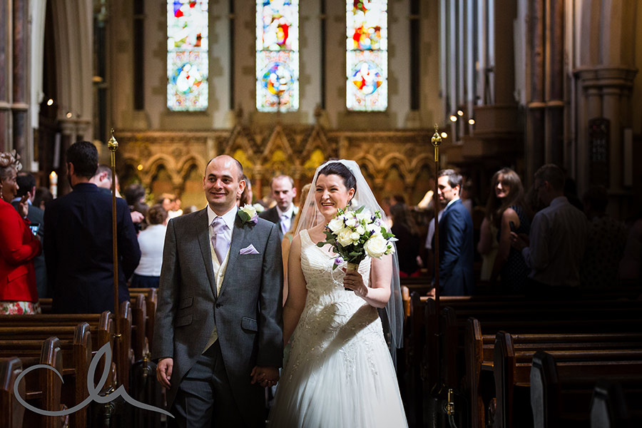 bride and groom exit Christ Church Southgate as man and wife