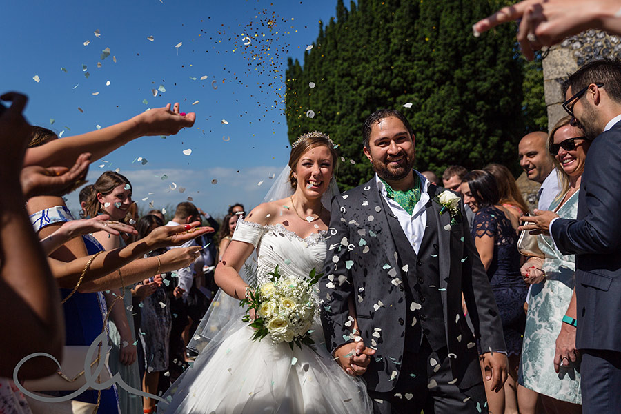 newlyweds have confetti showered over them at Reculver Church