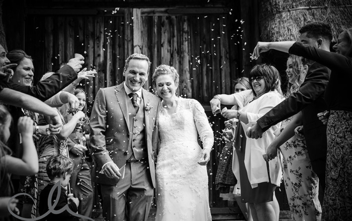 newlyweds have confetti showered over them at their Kent Village Wedding