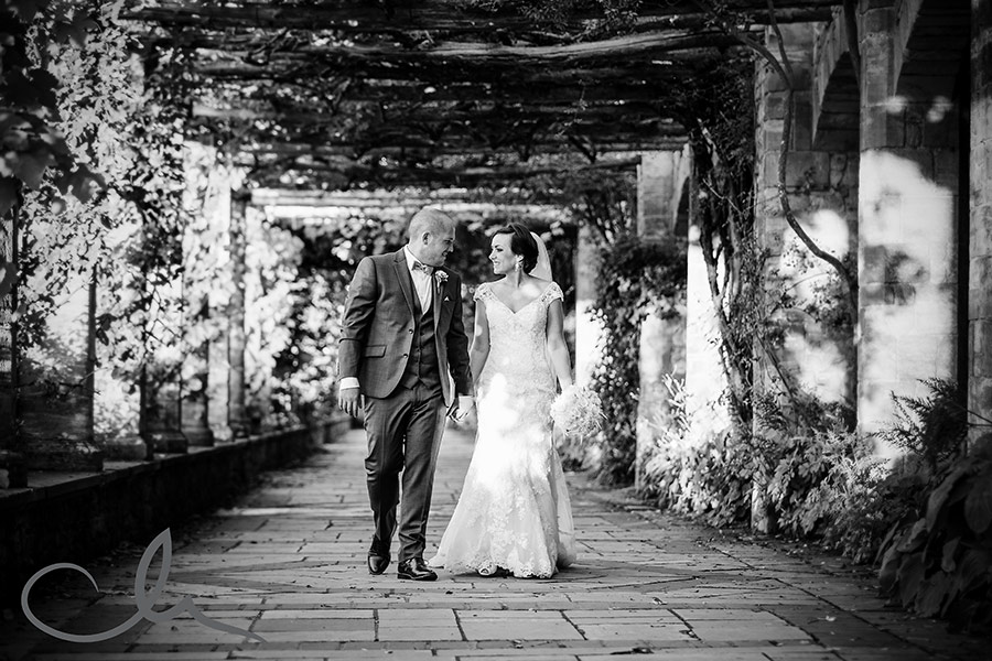 newly weds walk in the Italian gardens at Hever Castle Kent
