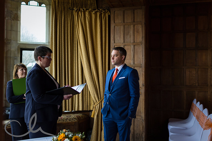 Lympne Castle Wedding Photos - the groom gives his details to the registrar