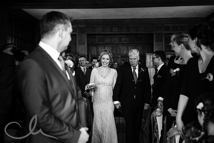Lympne Castle Wedding Photos - bride arrives with her father and sees her husband to be for the first time