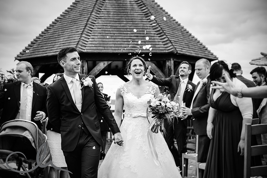 Kim & Alex's Ferry House Inn Wedding Photography - couple are showered in confetti