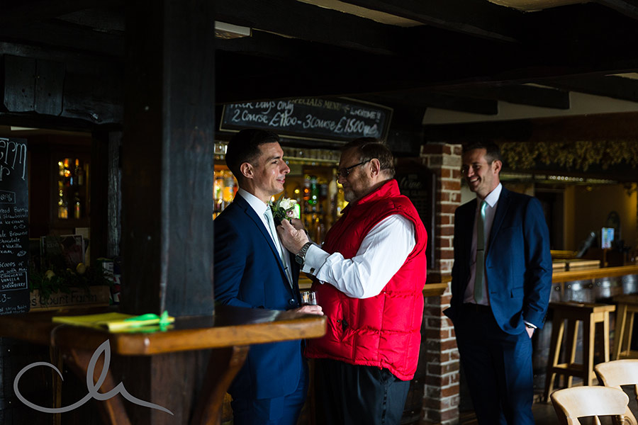 Groom has his buttonhole put on by the toastmaster at Ferry House Inn Sheppey