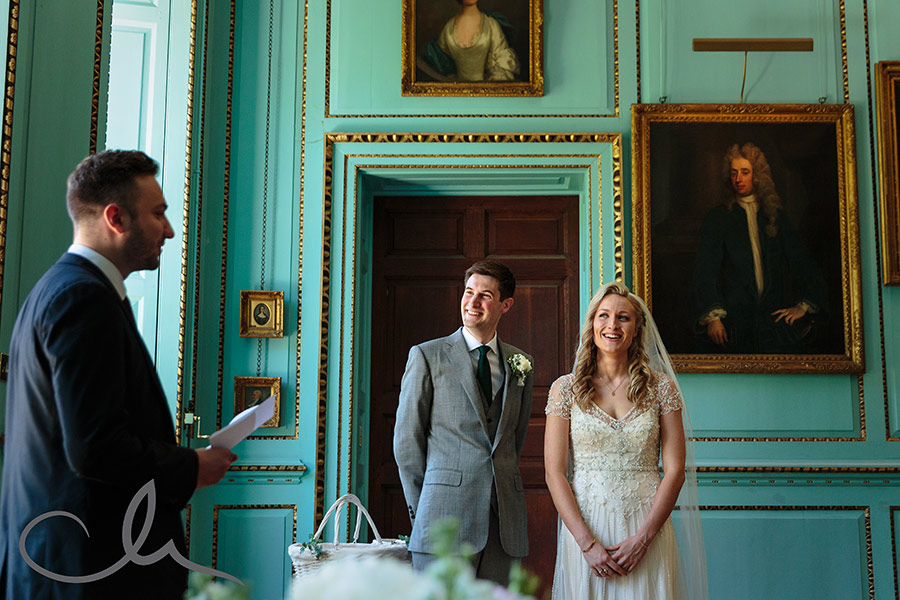 Couple listen to their friend give a speech at Bradbourne House Kent