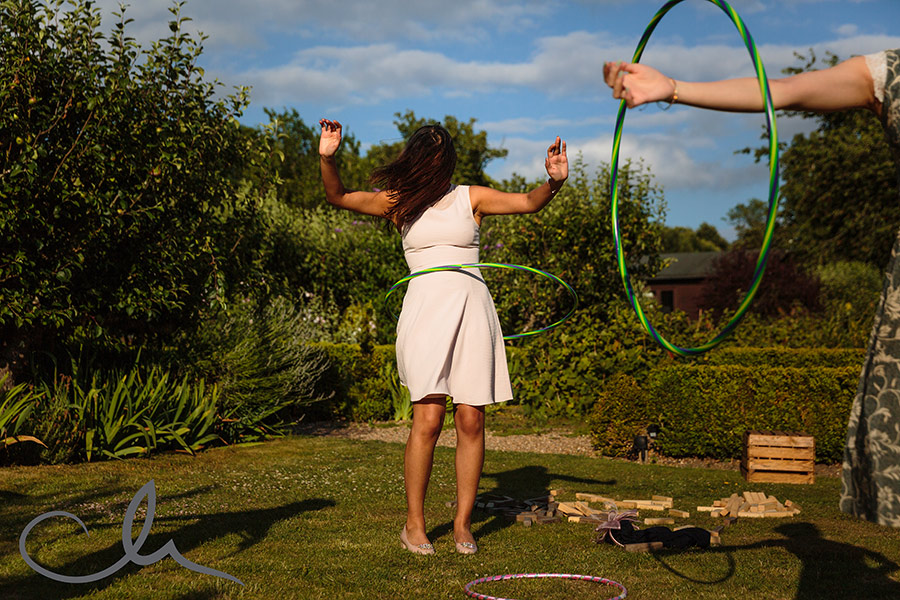 Guests play with the hula hoop at the Secret Garden Kent
