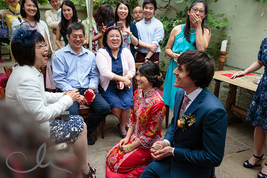 The bride and groom have their Chinese Tea Ceremony at their Secret Garden Wedding in Kent