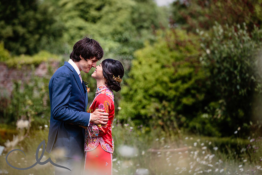 newleyweds are photographed in the wild flower garden at the Secret Garden Kent